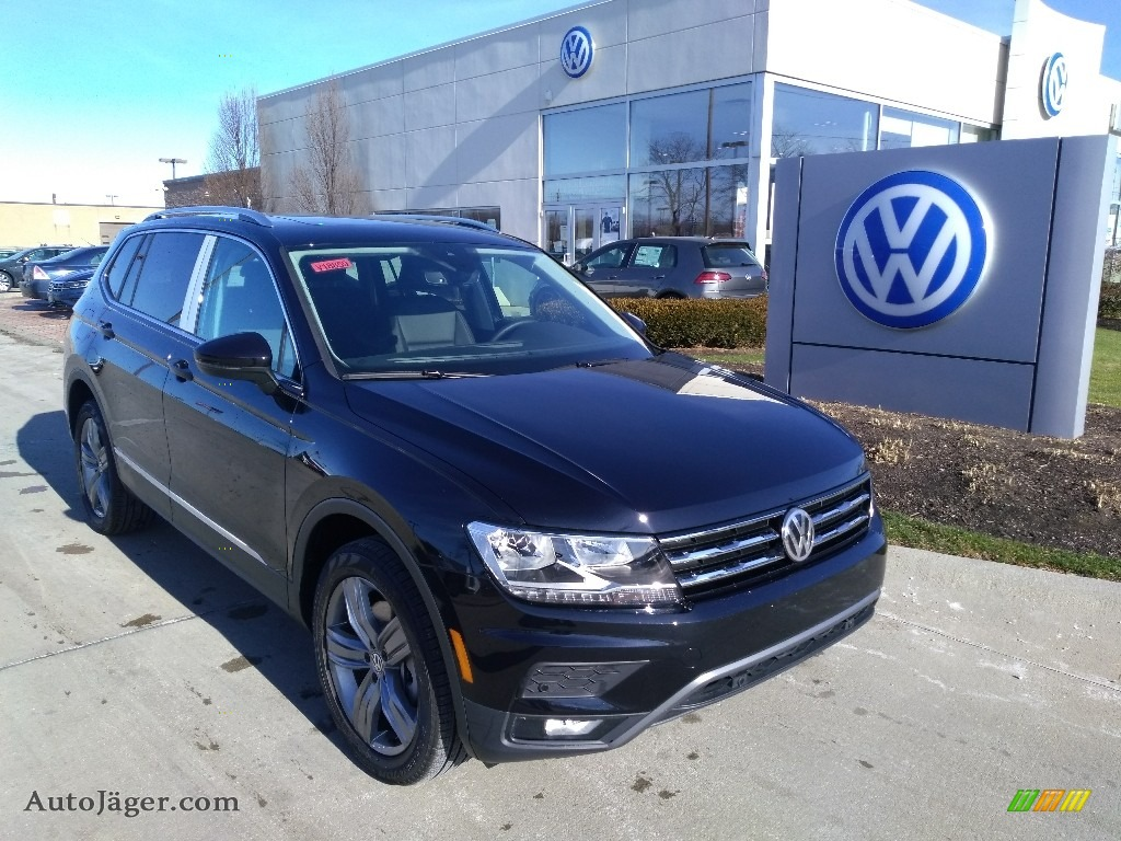 2020 Tiguan SEL 4MOTION - Deep Black Pearl / Titan Black photo #1